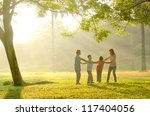 a family having fun playing in... | Shutterstock . vector #117404056