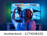 a gamer or a streamer girl at... | Shutterstock . vector #1174048102