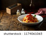 spaghetti with tomato sauce and ... | Shutterstock . vector #1174061065