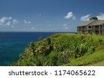 vacation rental on cliff... | Shutterstock . vector #1174065622
