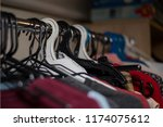 clothes hanger  jackets and... | Shutterstock . vector #1174075612