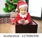 an excited baby at christmas... | Shutterstock . vector #1174082458