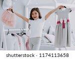 little cute girl choosing a... | Shutterstock . vector #1174113658