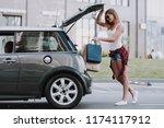 cute women putting shopping... | Shutterstock . vector #1174117912