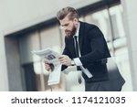 serious businessman reading... | Shutterstock . vector #1174121035