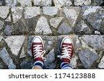man legs in sneakers standing... | Shutterstock . vector #1174123888