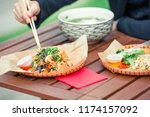 asian rice noodles with... | Shutterstock . vector #1174157092