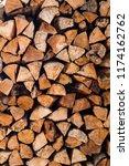 masonry from firewood. | Shutterstock . vector #1174162762
