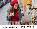 lovely female student in red... | Shutterstock . vector #1174167712