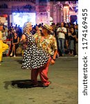 Small photo of An old couple wear fifties dressed and dance a swing song during the summer jamboree event at Senigallia 01 August 2018, Senigallia Italy