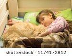 little girl sleeping in bed... | Shutterstock . vector #1174172812