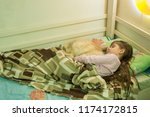 the girl sleeps in bed with a... | Shutterstock . vector #1174172815