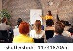 business woman explaining chart ... | Shutterstock . vector #1174187065