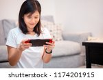 girl playing game at home | Shutterstock . vector #1174201915