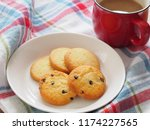 cup off coffee and cookies | Shutterstock . vector #1174227565
