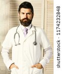 physician with confident face... | Shutterstock . vector #1174232848