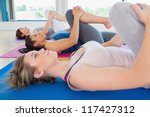 women lying on floor stretching ... | Shutterstock . vector #117427312
