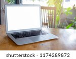 blank screen modern laptop in... | Shutterstock . vector #1174289872