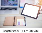 brown notebook with tablet on... | Shutterstock . vector #1174289932