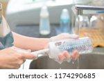mother cleaning baby milk...   Shutterstock . vector #1174290685