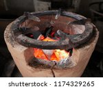 Charcoal In The Old Burner.