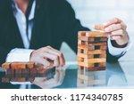 business woman placing wooden... | Shutterstock . vector #1174340785