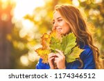 cute smiley woman holding... | Shutterstock . vector #1174346512