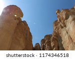 sun rays shine over the rock... | Shutterstock . vector #1174346518
