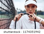 young beautiful sportswoman... | Shutterstock . vector #1174351942