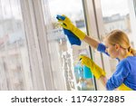 young woman in yellow gloves... | Shutterstock . vector #1174372885