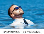 man in glasses in the water | Shutterstock . vector #1174380328
