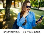 amazed girl listening on line... | Shutterstock . vector #1174381285