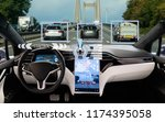 self driving car on a road.... | Shutterstock . vector #1174395058