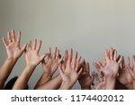 makes voting hands | Shutterstock . vector #1174402012