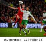 Small photo of Wales v Ireland, Cardiff City Stadium, 6/9/18: Wales' Chris Mepham chases the ball with Ireland's Callum Robinson