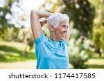 portrait of senior woman doing... | Shutterstock . vector #1174417585