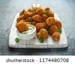 homemade breaded garlic... | Shutterstock . vector #1174480708