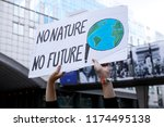 Small photo of Brussels, Belgium. 8th Sep. 2018.Activists hold placards and chant slogans during a demonstration to demand immediate an action on climate change in front of European Parliament.