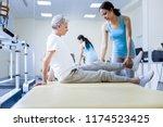 weak muscles. qualified... | Shutterstock . vector #1174523425