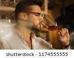 best drink. portrait of a... | Shutterstock . vector #1174555555