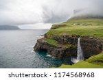 view of mulafossur waterfall ... | Shutterstock . vector #1174568968