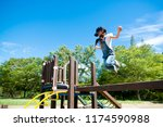 girl to jump in the park | Shutterstock . vector #1174590988
