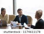multiracial partners... | Shutterstock . vector #1174611178