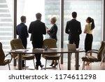 multiracial workers colleagues... | Shutterstock . vector #1174611298