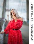 sensual blonde woman wearing ... | Shutterstock . vector #1174614865