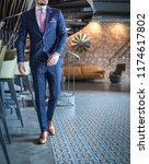 man in custom tailored... | Shutterstock . vector #1174617802