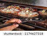 chef putting pizza ready for... | Shutterstock . vector #1174627318