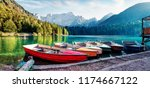 six pleasure boats on fusine... | Shutterstock . vector #1174667122