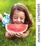 happy small girl lying on the... | Shutterstock . vector #1174690045