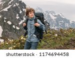hiking tour concept. young... | Shutterstock . vector #1174694458